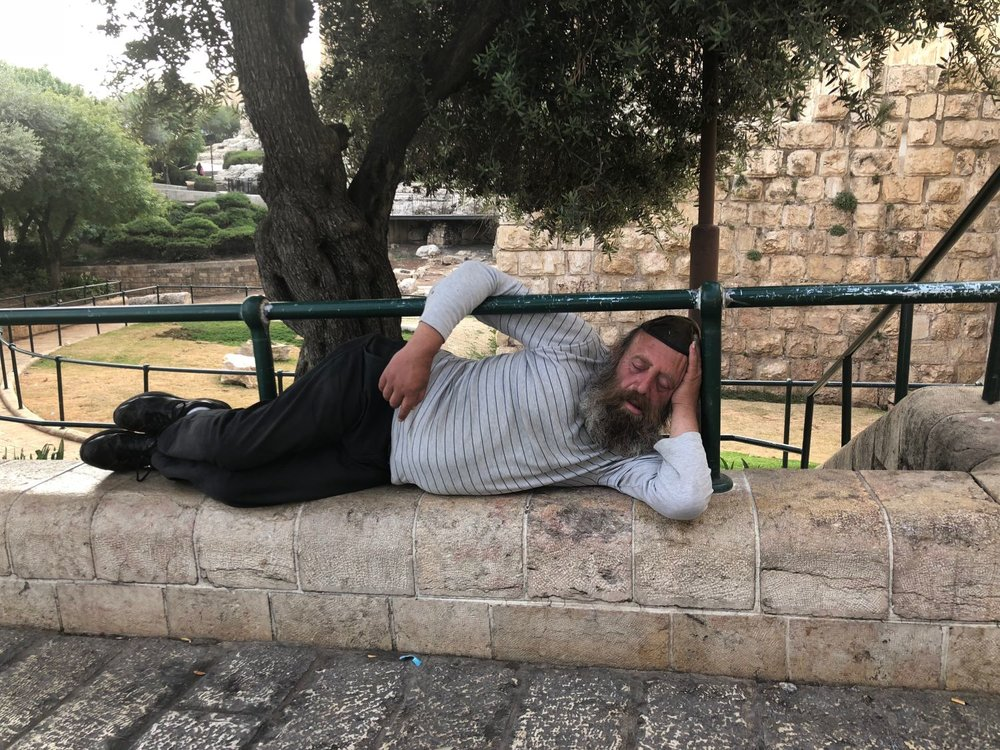 Jerusalem old city | Jew with kippa sleeping on a wall | photo sandrine cohen