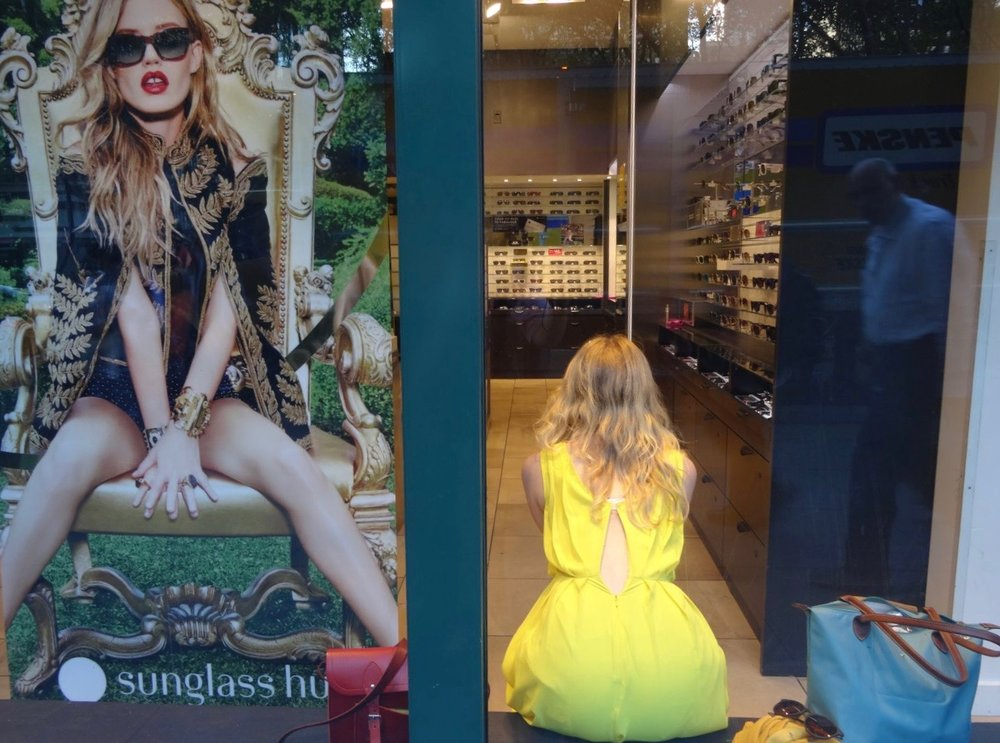 New York | Yellow woman in window shop on Madison avenue | photo sandrine cohen