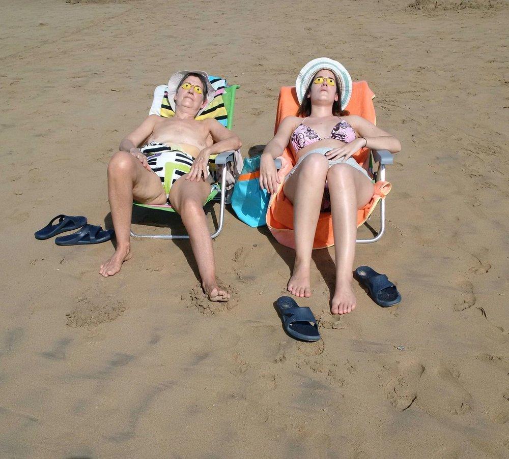 Basque coast | Women sunbathe on the beachMartian women | photo sandrine cohen