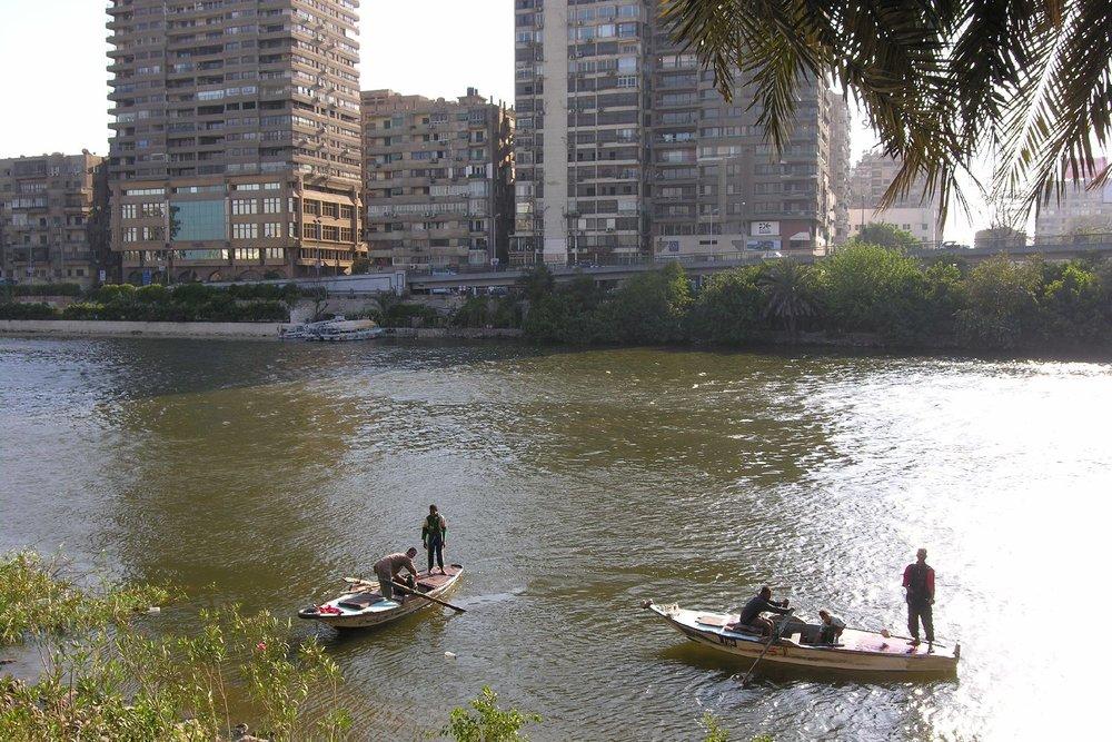 Cairo  The Nile  Fishermen on the Nile   Zamalek buidings  ©sandrine cohen