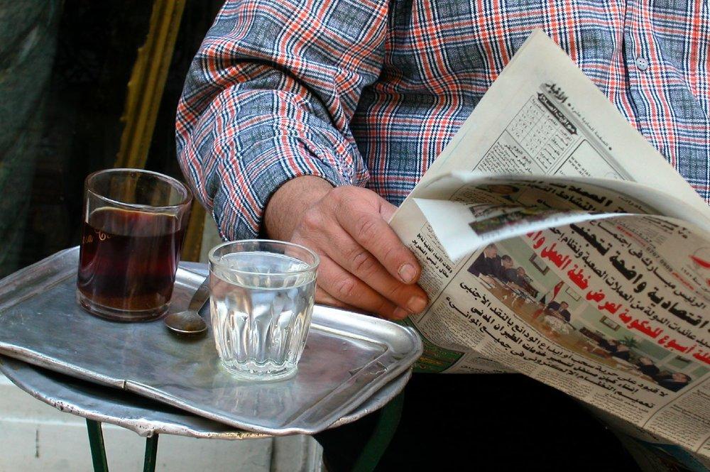 Cairo   Egyptian man with newspaper and tea   ©sandrine cohen