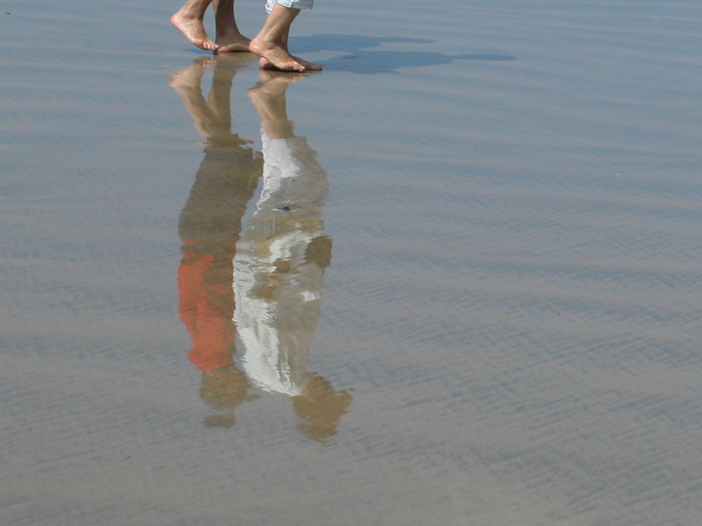 Basque coast | A couple reflection in the water |Surfers |©sandrine cohen