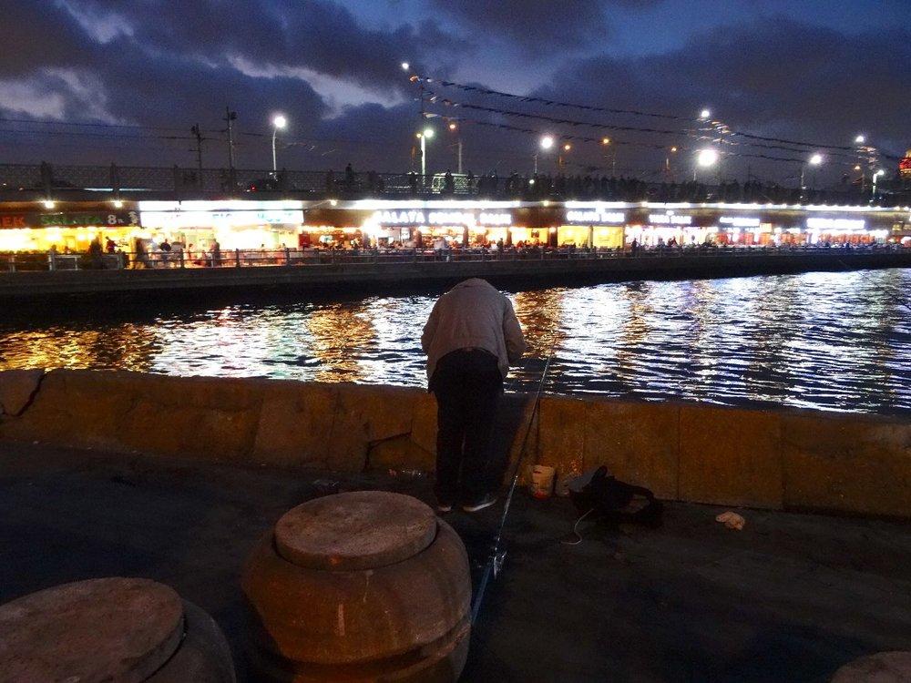 Istanbul | Turkey | Bosphurus | Galata bridge | Fisherman on a dock of the Bosphurus | ©sandrine cohen