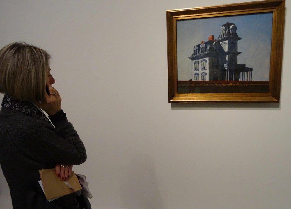 Fondation Louis Vuitton Paris | Exhibition MOMA | Woman looking Edward Hopper board | photo sandrine cohen