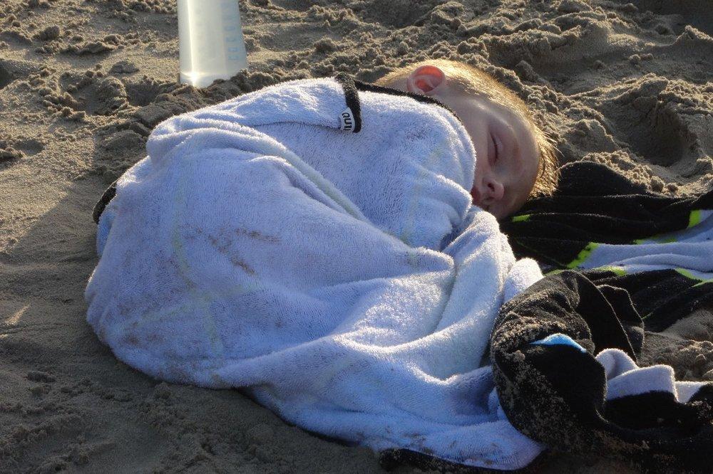 Baby sleeping on the beach | Scene of daily life | photo sandrine cohen