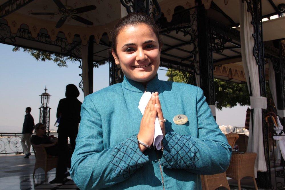 Udaipur 7 | Udaipur Lake | pier for the lake palace | Lake Palace employee | Namaste | ©sandrine cohen
