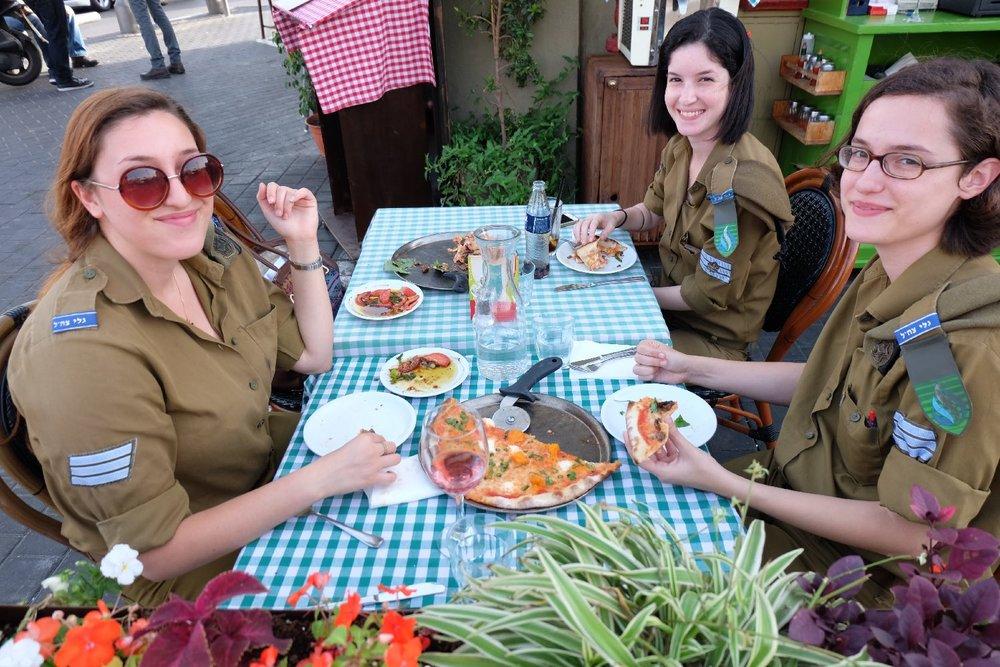 Jaffa | Military women in restaurant | Flea Market | Photo sandrine cohen