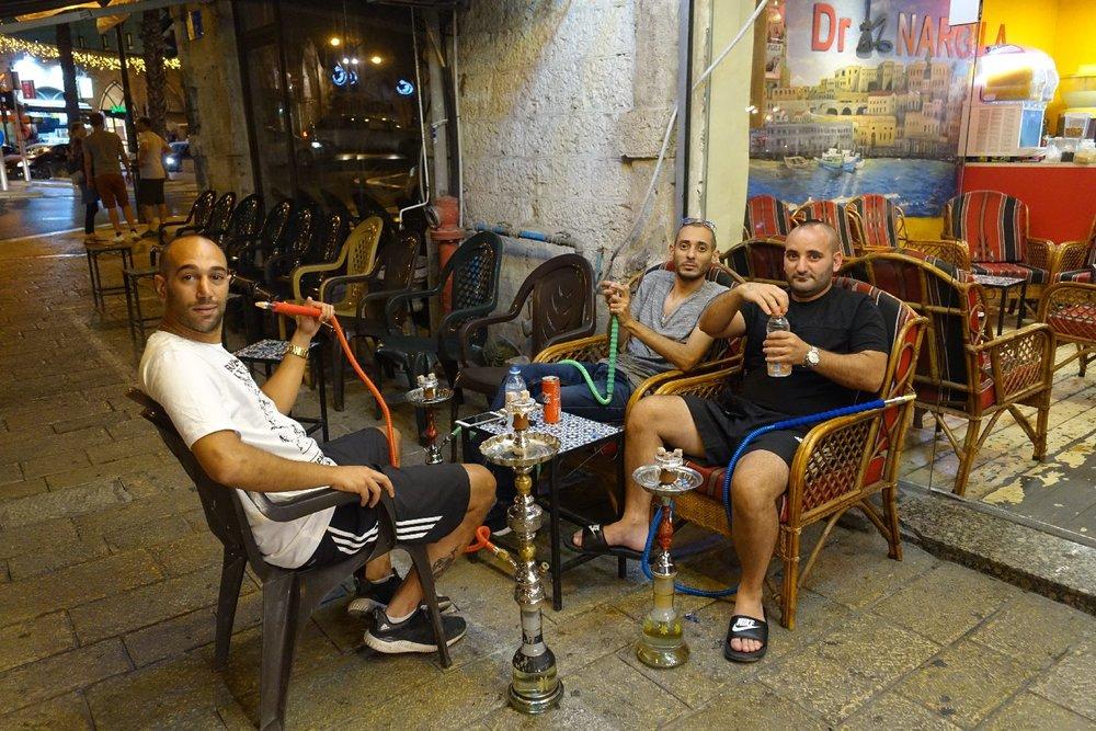 Jaffa | Young boys smoking chicha in the street | photo sandrine cohen
