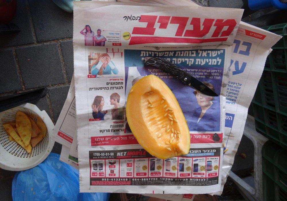 Haifa | Melon on a israeli newspaper | photo sandrine cohen
