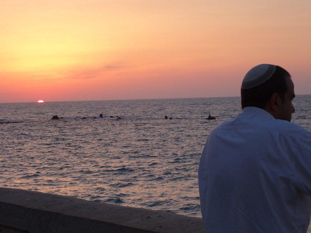 Jaffa | Tel-Aviv |Jewish with kippa looking the sea | Sunset on the sea | photo sandrine cohen