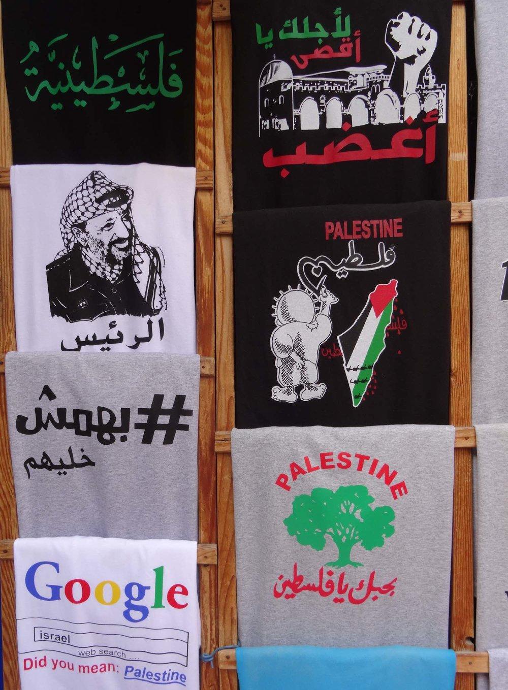 Jerusalem old city | T-shirt shop | Arafat on t-shirt | Palestine land on t-shirt | photo sandrine cohen