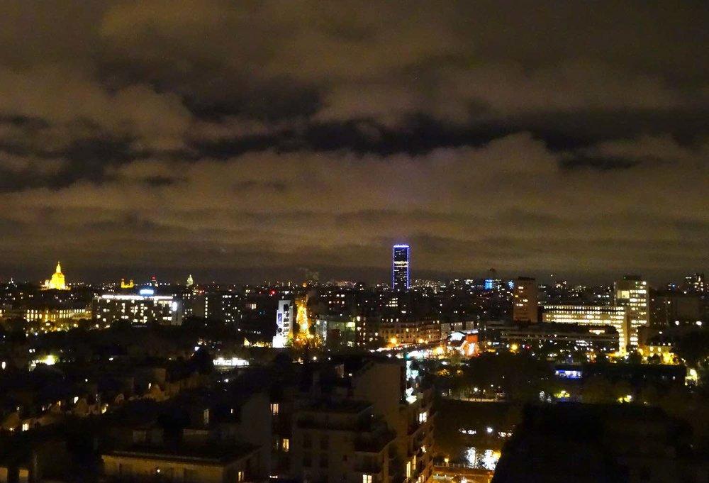 Vue de Paris la nuit | View of Paris at night | sky with clouds | Dôme des Invalides | Tour Montparnasse | photo sandrine cohen