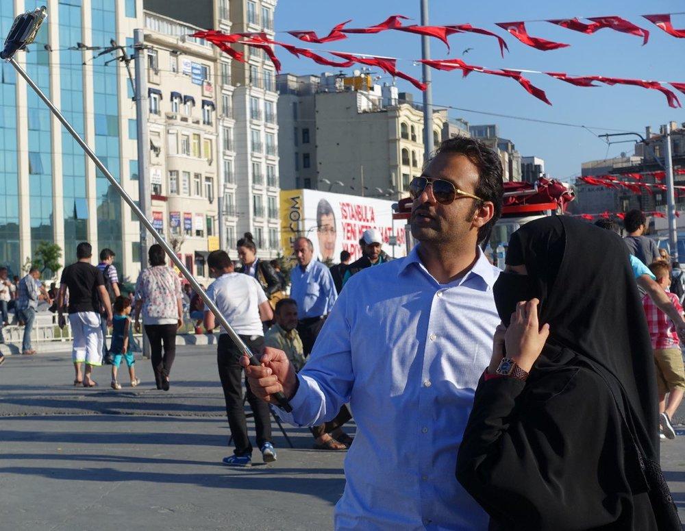 Istanbul | Selfie at Taskim Place | Muslim couple taking a selfie | ©sandrine cohen