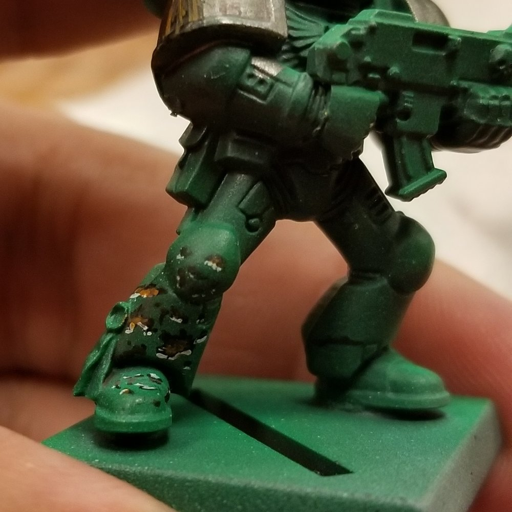 Battle Damage on a Space Marine