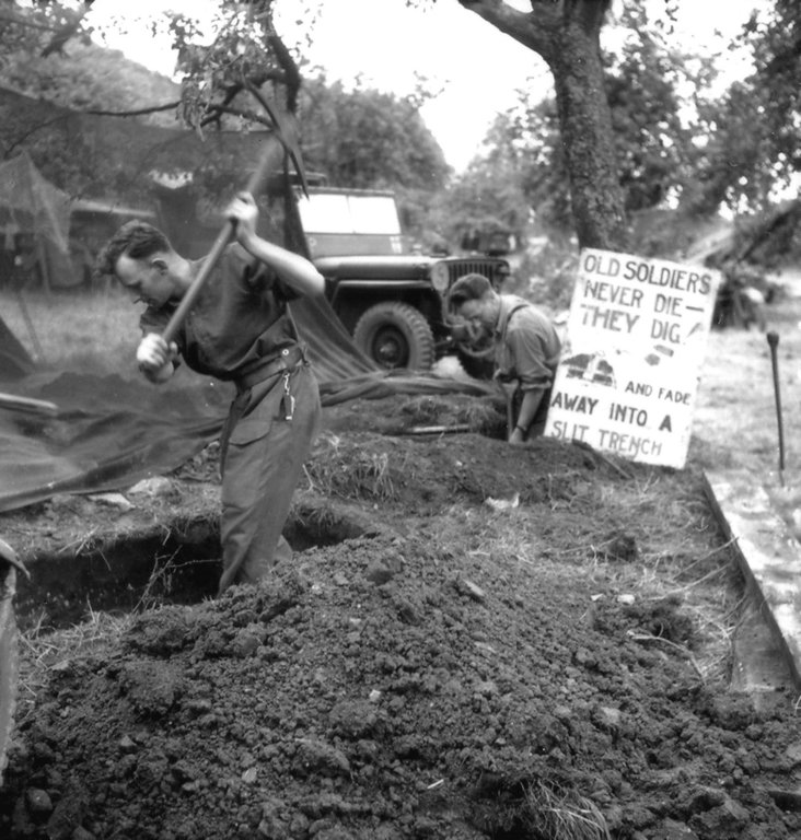 Two Canadian digging slit trench with Phantom patrol jeep behind