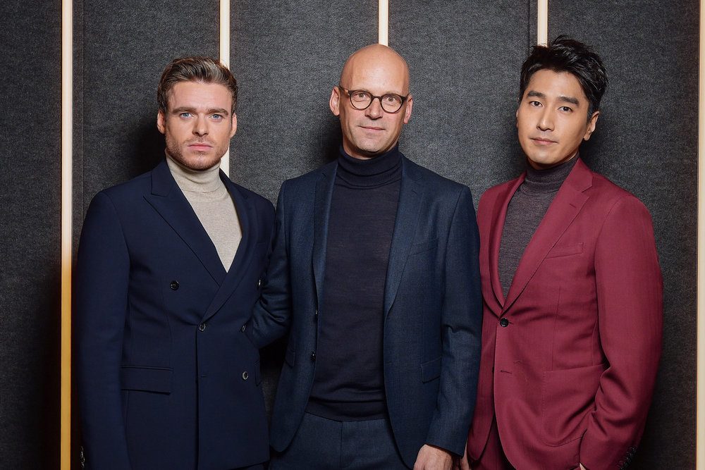 From Left to Right: Richard Madden, Mark Langer, and Mark Chao backstage at the BOSS Fall/Winter 2019 show at Basketball City during New York Fashion Week on Wednesday, February 13, in New York City. Photography, Courtesy of BOSS.