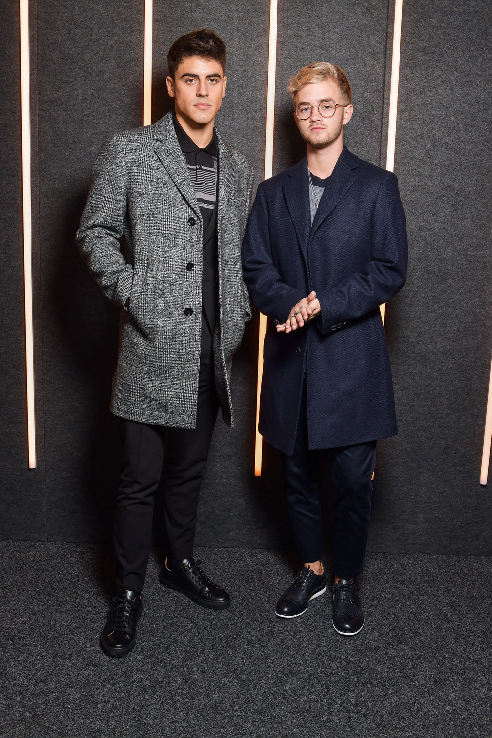 From Left to Right: Jack Gilinsky, and Jack Johnson backstage at the BOSS Fall/Winter 2019 show at Basketball City during New York Fashion Week on Wednesday, February 13, in New York City. Photography, Courtesy of BOSS.