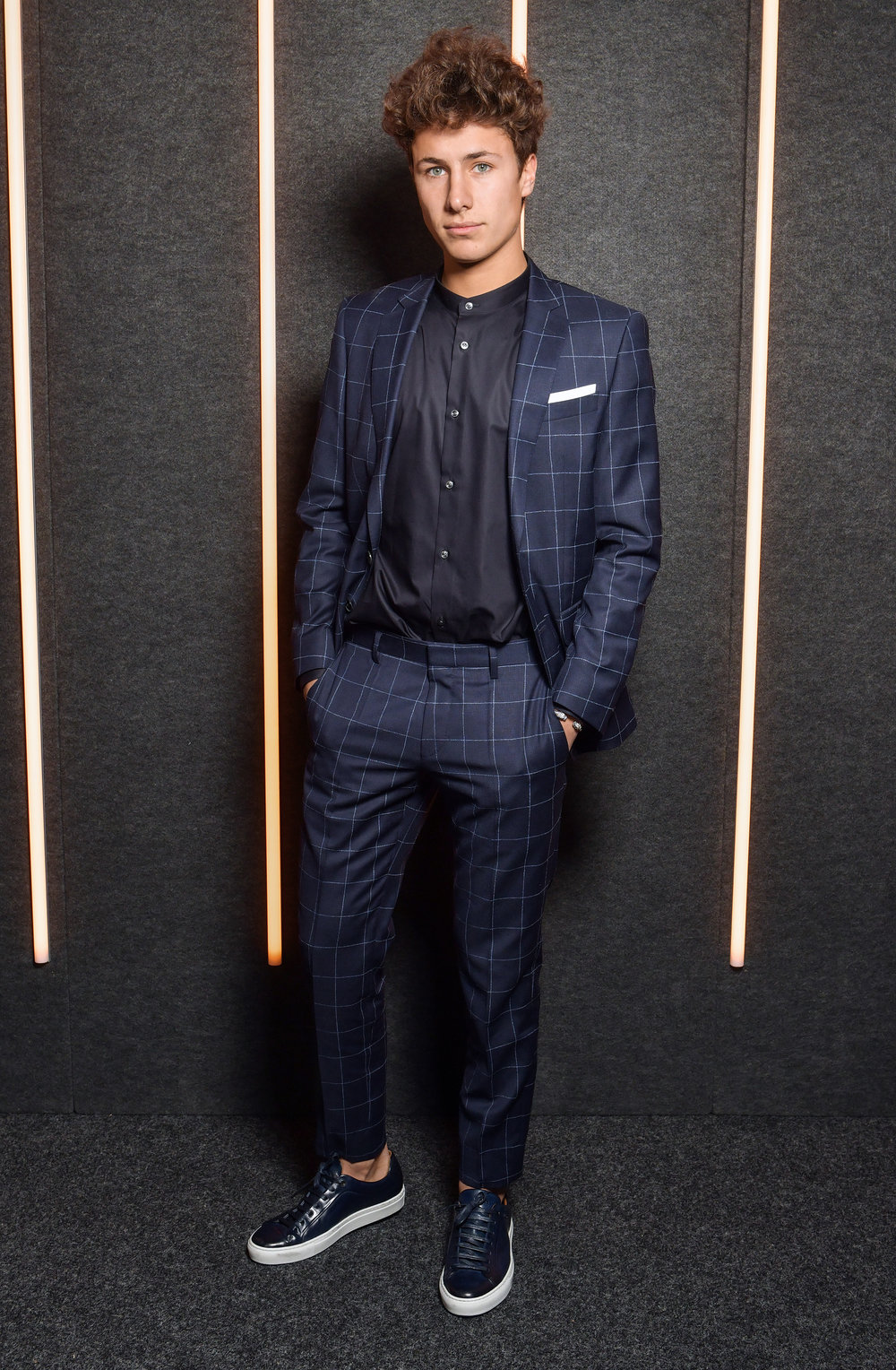Juanpa Zurita backstage at the BOSS Fall/Winter 2019 show at Basketball City during New York Fashion Week on Wednesday, February 13, in New York City. Photography, Courtesy of BOSS.