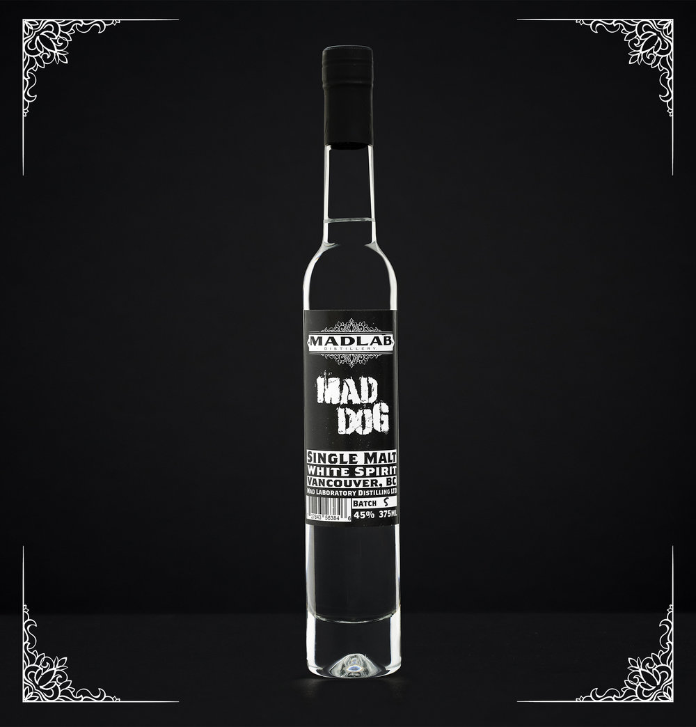 Mad Dog Single Malt - This ineffable spirit is one of great discussion; it's not whiskey, but it's not anything else either. It's not moonshine, we made it legally, it's just... Mad Dog!Mad Dog is a raw spirit, straight off the still, unfiltered, full bold flavour, and intense!2017 Canadian Artisan Spirit Competition gold medal winnerTasting Notes:Rich chocolate and caramel notes, strong grain flavour, sweet and intense. Makes for fantastic classic whiskey cocktail variations, old fashioneds, Manhattens, and beautiful with chocolate and cream.