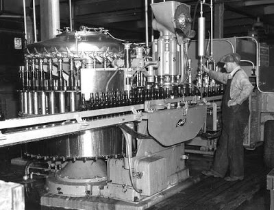 Lethbridge Sick's Brewery, view of the beer bottle assembly line.  Courtesy the Galt Museum & Archives: P19752209038.