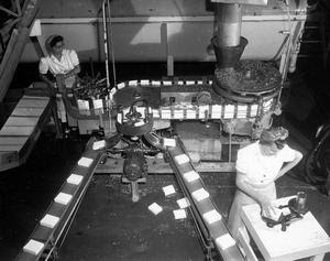 Workers weighing packaged peas at the Broder's Canning Company, July 24, 1953. Courtesy Galt Museum Archives. P19752501029.
