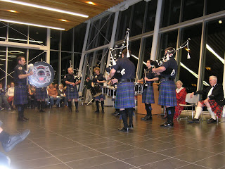 The Lethbridge Firefighters Pipes and Drums with Senator Joyce Fairbairn and Alex Lawson in the background