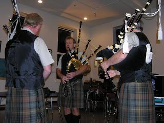 Lethbridge Legion Pipe and Drum Band warming up, under the leadership of David Kaminski (facing the camera)