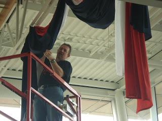 Brad putting up display.JPG