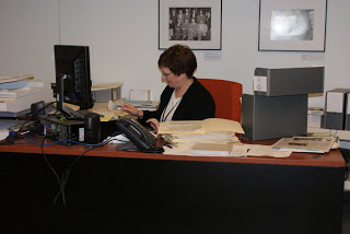 Barb, an Archives volunteer, cataloguing donations and working on library integration.