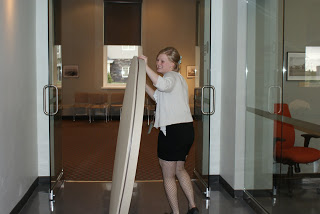 Lara, front desk attendant, getting one of our meeting rooms ready for its next function.