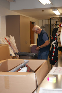 Tom, a volunteer, working down in the Collections area.