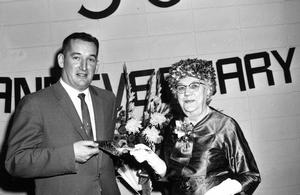 Presentation from Mrs. Matilda Galbraith of the silver trowel used to set the cornerstone of Galbraith School to Jim Clark at the Galbraith 50th Anniversary celebrations. Galt Archives 19752314255.