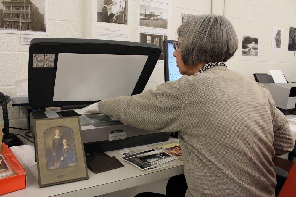 Volunteer Alice scans photos at the Archives!