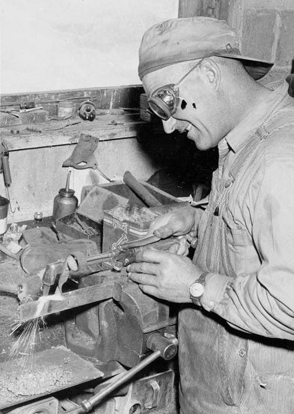 Andrew Briosi welding in his shop.  Courtesy Galt Museum & Archives: 19752990127