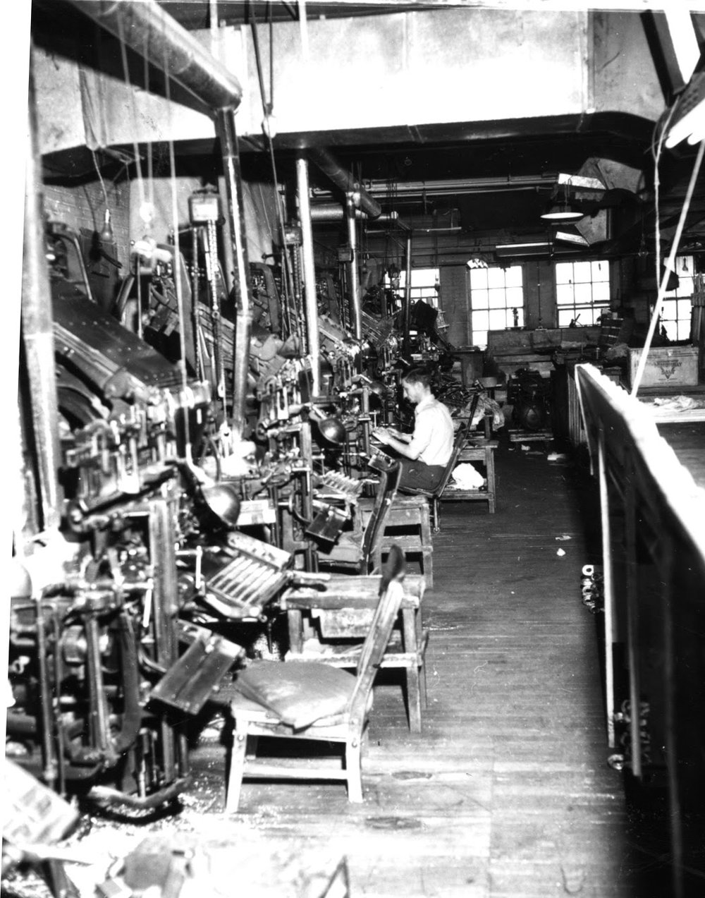 The printing room at the Herald worked overtime during the early days of the First World War. In addition to the regular daily issue, several special editions were printed during the first weeks of August 1914, bringing news directly from the telegraph wires to the citizens of Lethbridge.  Courtesy the Galt Museum & Archives: 19752201394