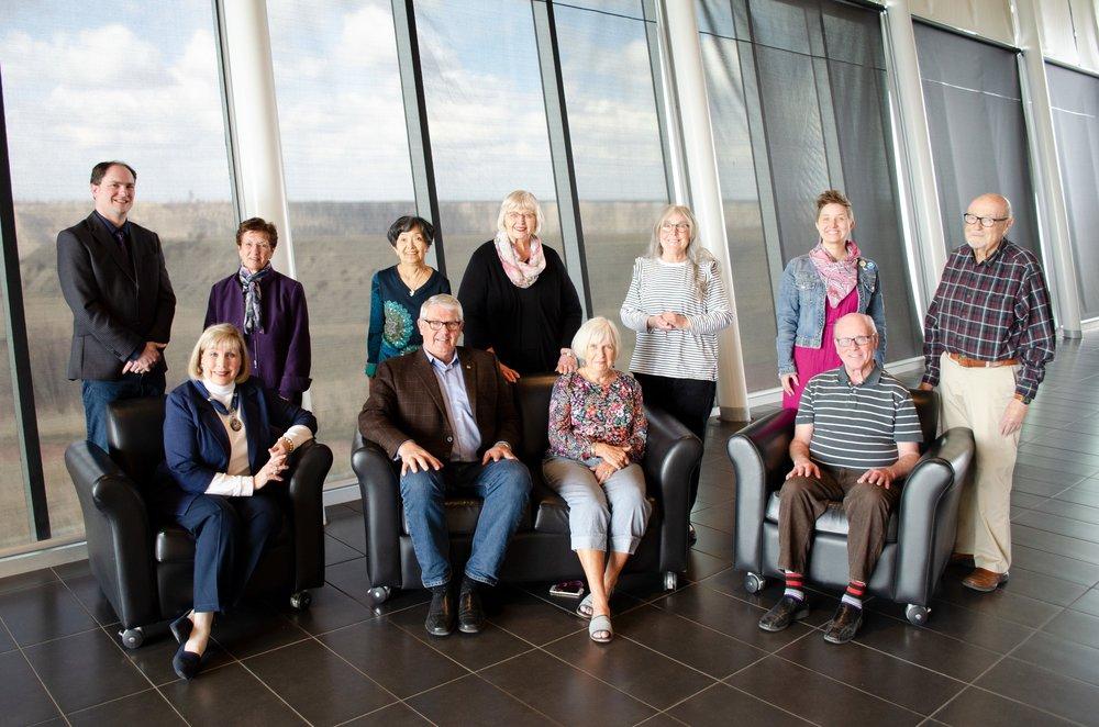 Standing: Chris Roedler, Penny Dodd, Ruth Liska, Mary Oordt, Linda Cofman, Hilary Squires, Allyn Mills  Seated: Elisha Rasmussen, Dr. Glenn Coulter, Sandy Whyte, Ian McDonald.