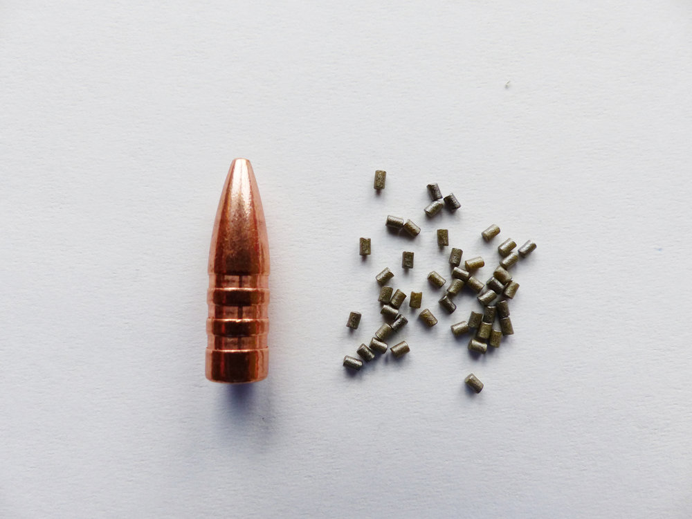 This image illustrates the amount of powder contained within 1.6 gr. We used a Barnes .223 T.S.X. 53 gr. bullet for scale.