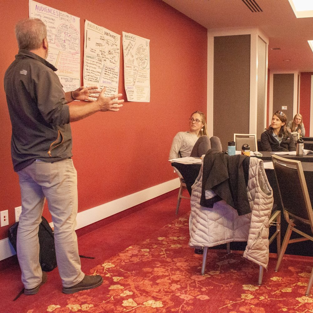The morning fundamentals workshop combined facilitator presentations, individual reflections, group brainstorming and problem solving, and participant presentations (pictured here) to engage the many learning styles in the room.