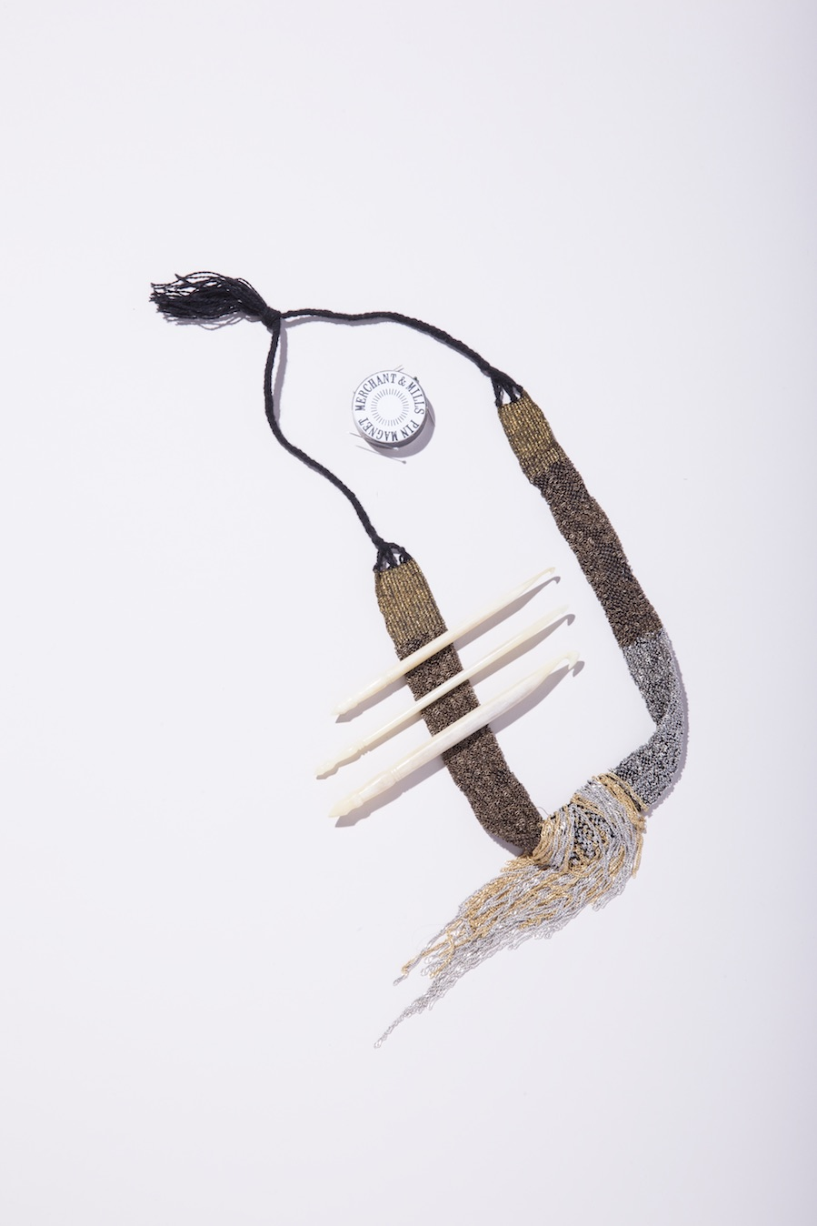 Jess Feury  Beaded Necklace;  Fringe Supply Co  Bone Crochet Hooks;  Merchant & Mills  Pin Magnet.