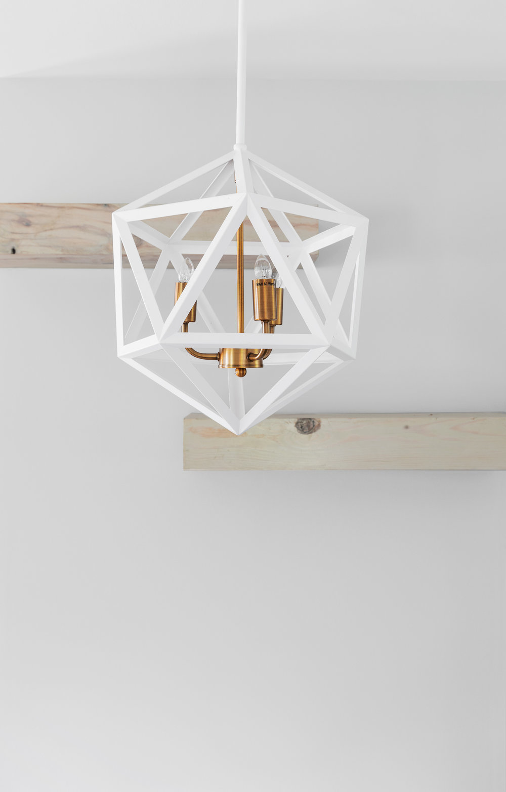 Construction photography of a custom light fixture in a newly fi