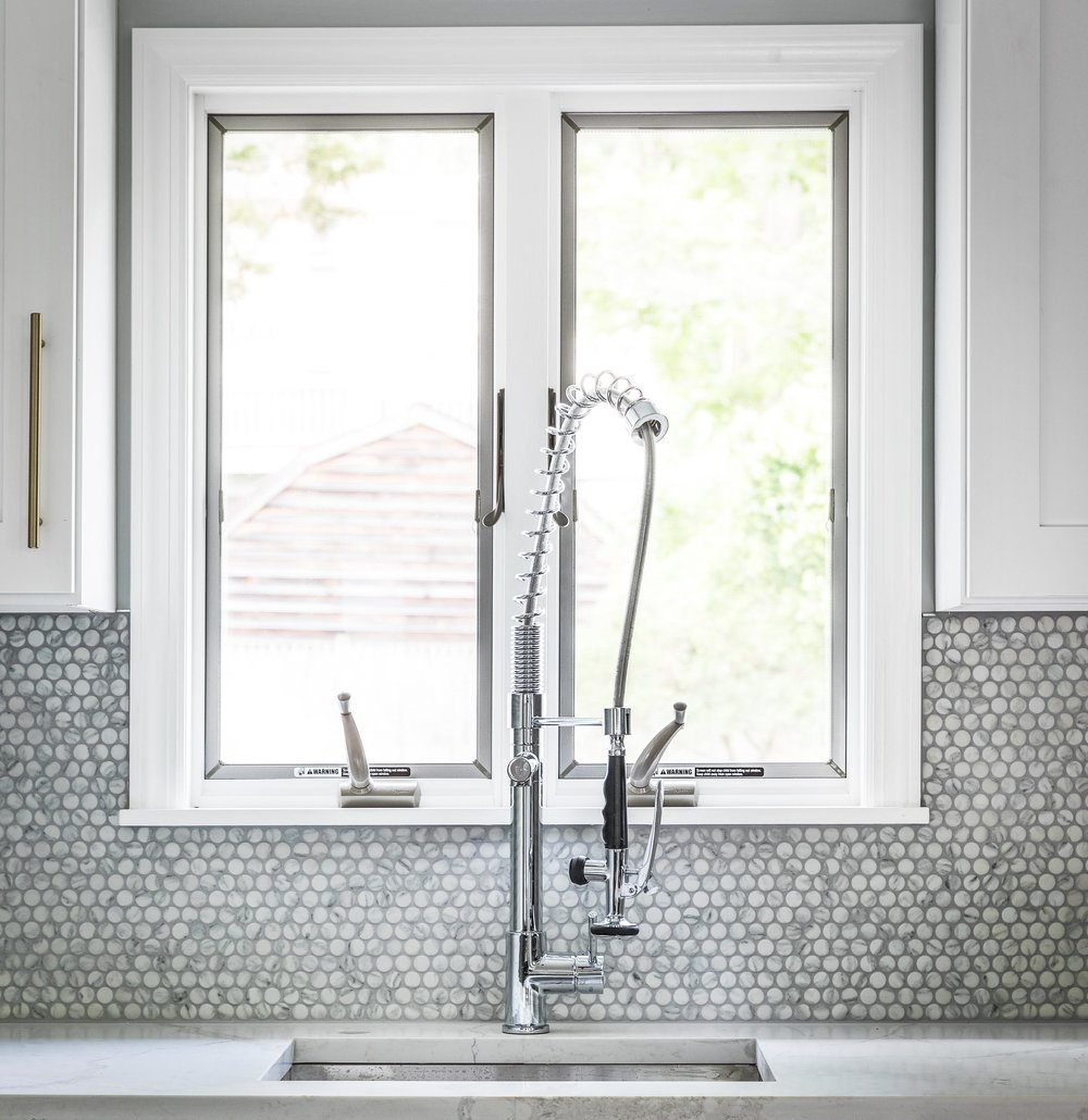 Construction photography of a Kohler sink and faucet in a newly