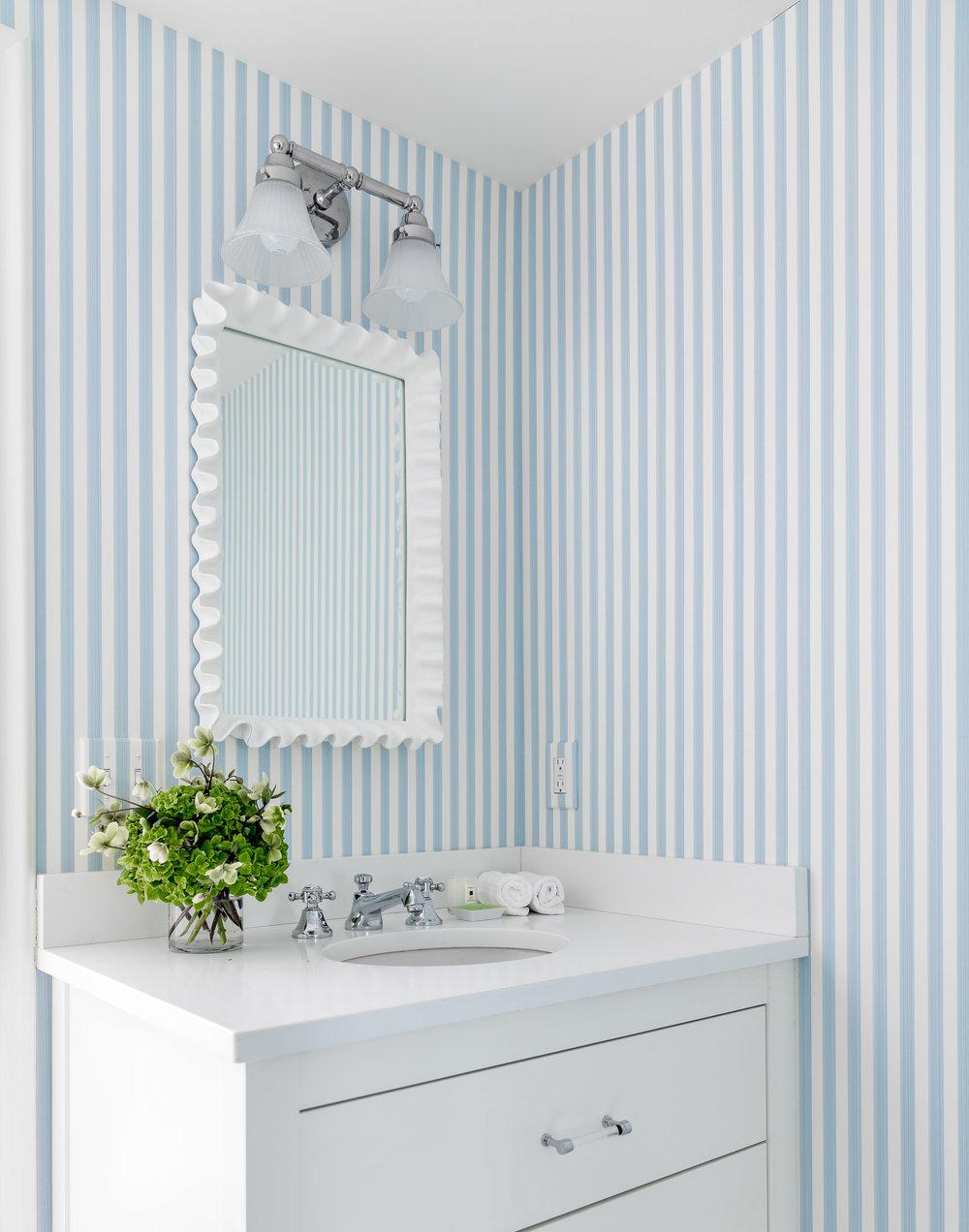 Blue & white striped bathroom wall.