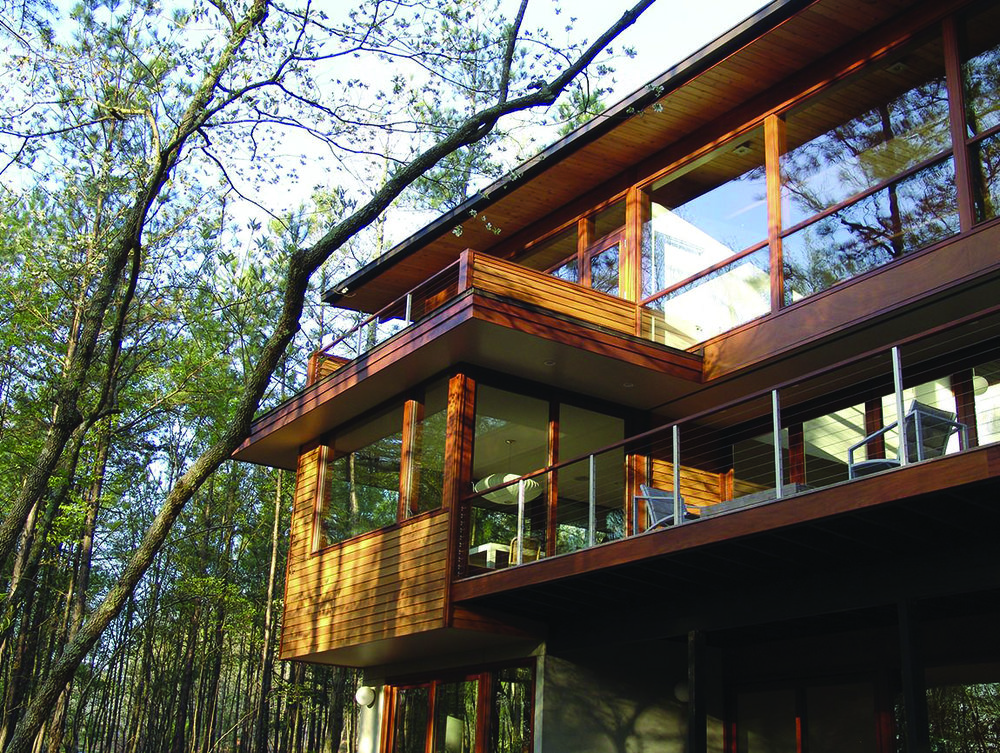Ron and Sandra Simblists's home was featured in the 2018 MA! Modern Architecture Tour and has expansive views of forest.