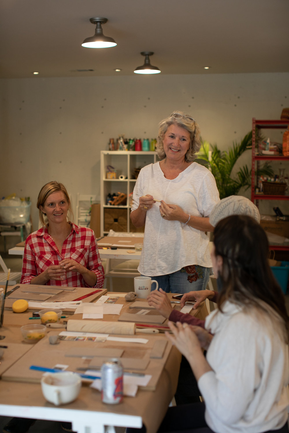 Julie McKinney    instructs the first Ceramics Class at Art Farm Studio. Photo by    J. Ashley Photography   .