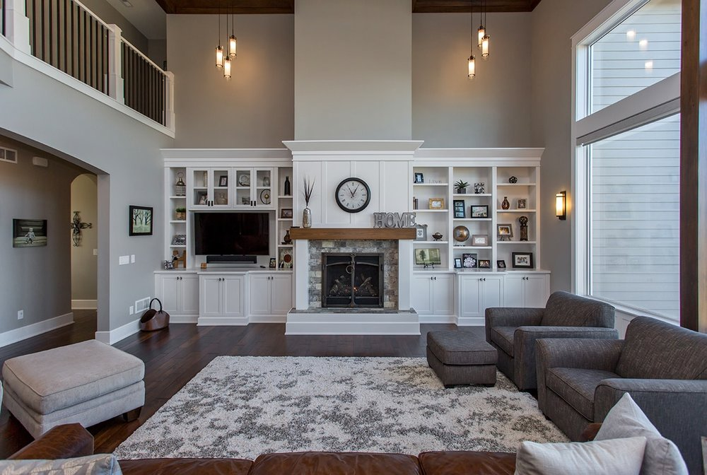The Heck Project - A contemporary home featuring custom built-ins such as bookshelves, wine rack and a fireplace in the master bedroom.