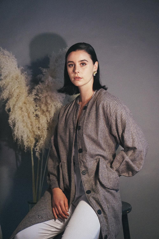 coat:  Muza , Jewelry: Nina Rios