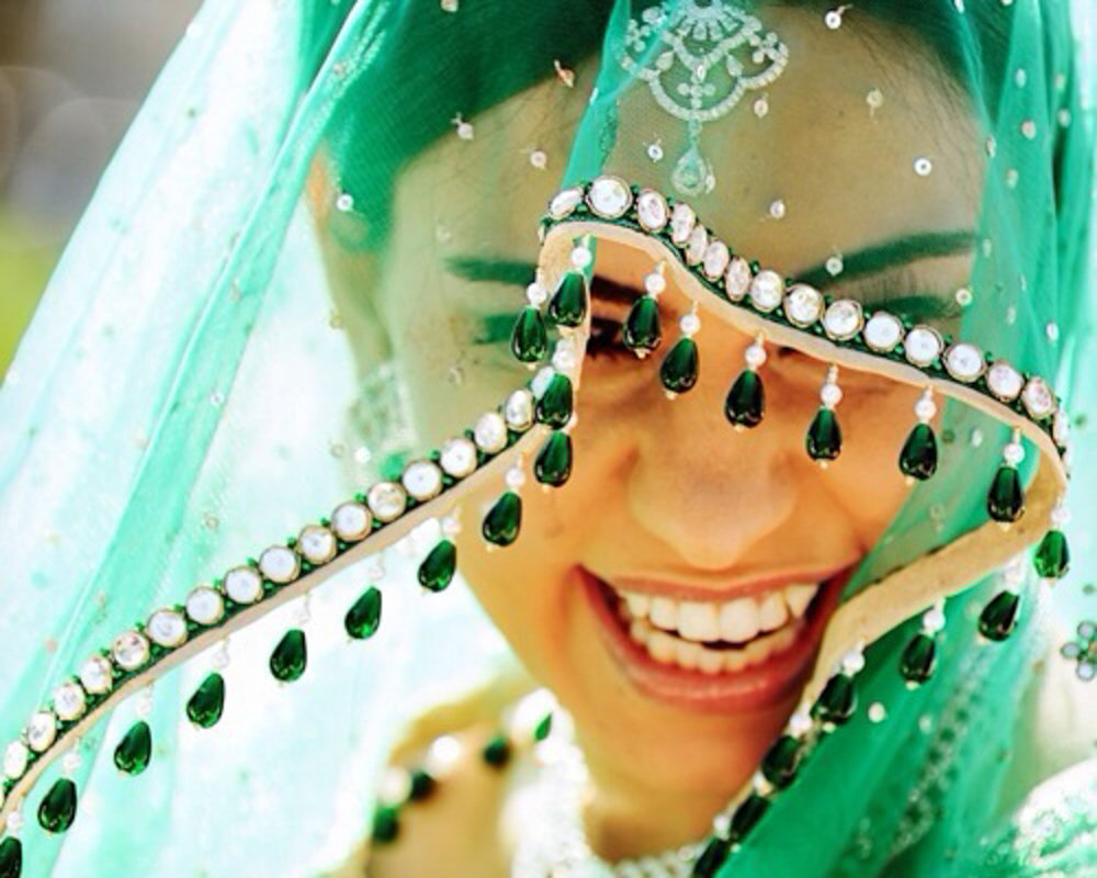 smiling bride with exotic veil