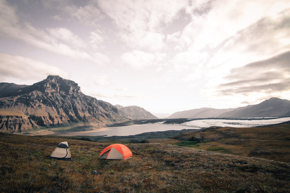 Backcountry Backpacking Campers Set Up Tents after Dropoff
