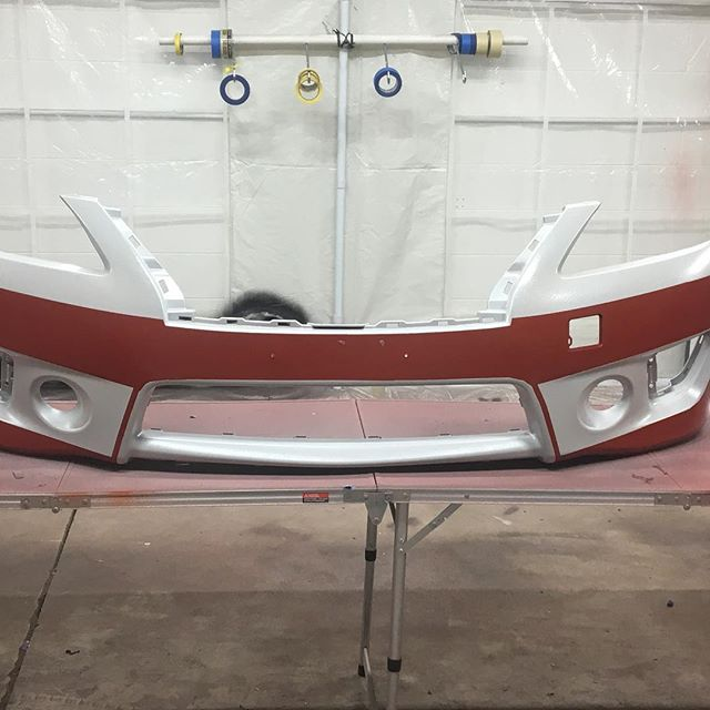Red and metallic white bumper still in the works