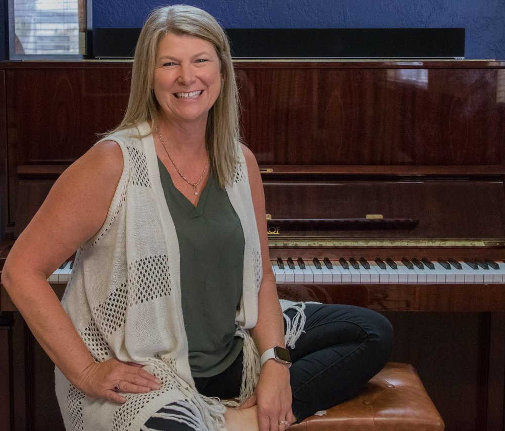 Diane Correia, studio owner and Advanced Simply Music© teacher: - Diane Correia's first desire to play the piano came at the age of 4 or 5 when she played La Bamba over and over on a toy keyboard (La Bamba is still a favorite song).Fast-forward many years later: Diane is a wife, mother, piano teacher, and the owner of Roseville Piano Studio. After teaching for nearly 20 years and opening a commercial studio in 2012, seven years ago, Diane believes that the success of her studio is directly related to the wonderful teachers and families in her studio family.When she is not teaching, Diane can be found riding her tandem bike with her husband Mark, playing with her two dogs, Buck and Ali, or flying around the country as a part-time flight attendant. Yes, a flight attendant! Diane believes that her upbeat, flight-attendant personality and her cheerleading approach to lessons are strongly connected.Roseville has been very good to Diane and her studio. She has loved meeting so many wonderful people in her town and can't wait to meet your family.